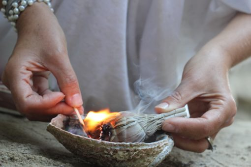 Lori A Andrus hands sage fire